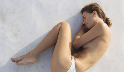 Barebreasted Young Woman Sleeping in the Sun --- Image by © Joerg Steffens/zefa/Corbis