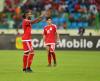 Piłkarze uspokajają kibiców w czasie meczu Ghana - Gwinea Równikowa w czasie Pucharu Narodów Afryki